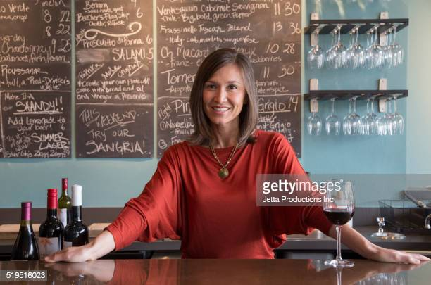 Mixed race woman working in wine bar