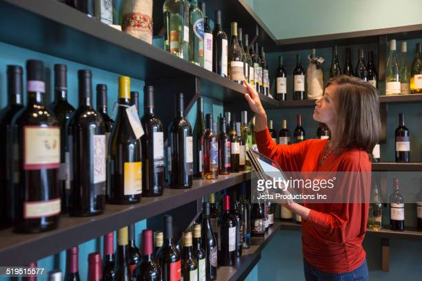 Mixed race woman working in wine shop