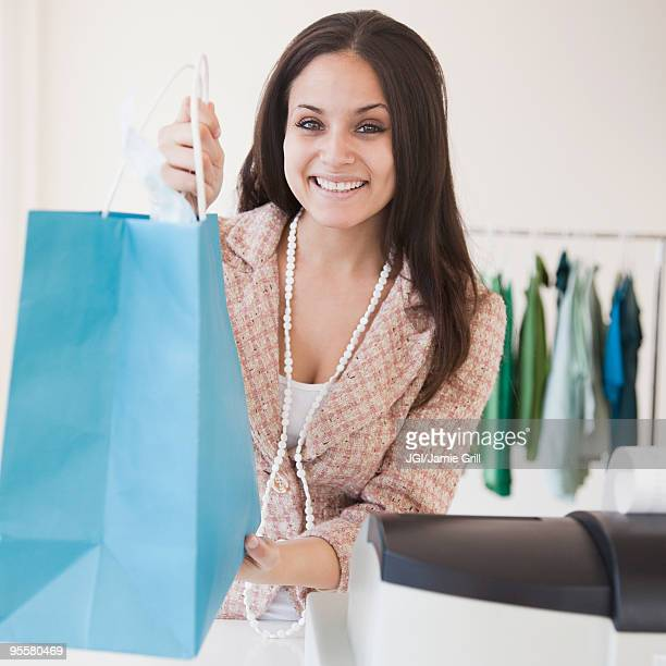 Mixed race woman working on clothing shop