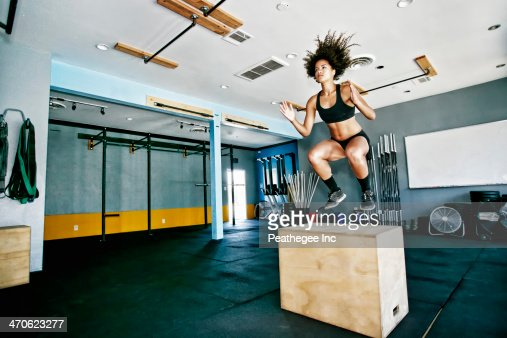 Mixed race woman working out in gym