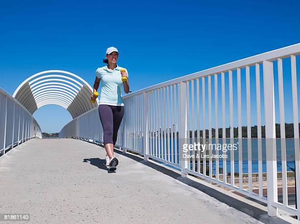 Mixed Race women exercising on walkway
