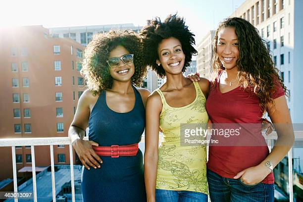 Mixed race women on urban rooftop