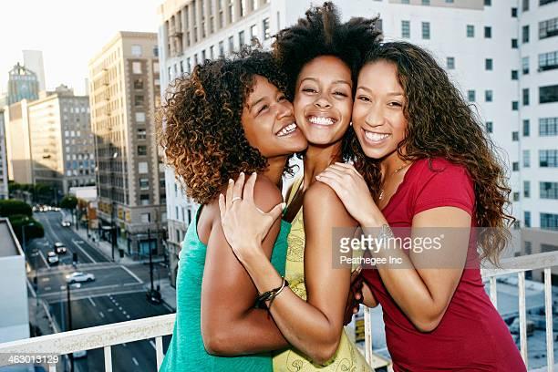 Mixed race women on urban rooftop