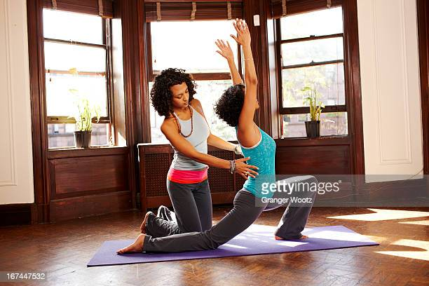 Low lunge pose stock photos and pictures getty images for Living room yoga sessions