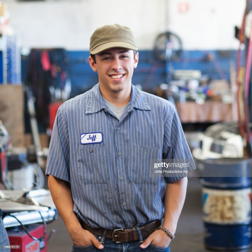 Mixed race worker in auto repair shop