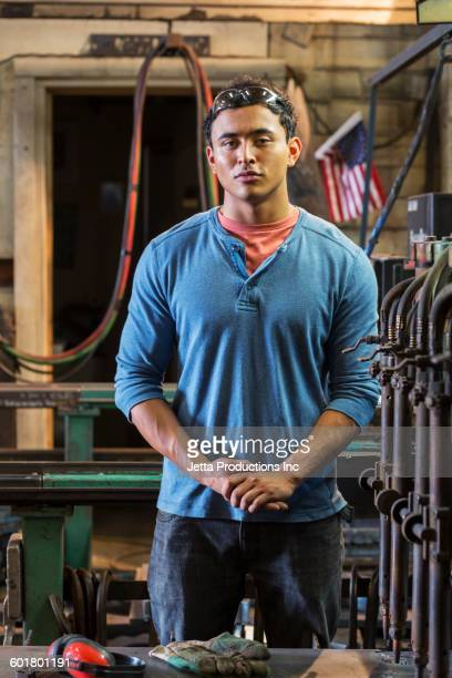 Mixed race worker standing in factory