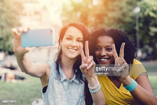 Mixed raced girls taking a selfie together