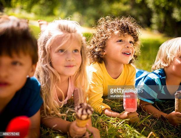 Mixed racial group of child friends eating ice creams