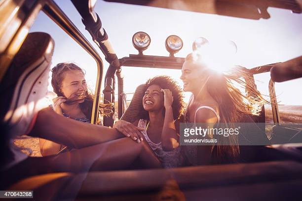 Mixed racial group of friends on road trip to beach