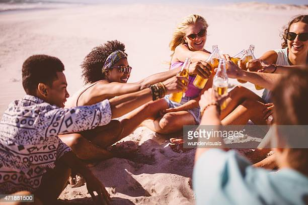 Mixed racial group of friends saying cheers with beer