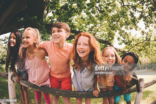 Mixed racial group of laughing children in a summer park