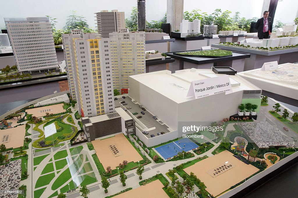Mexicos president enrique pena nieto speaks at the real estate a mixed use architectural model for future development sits on display during the real estate investment sciox Images