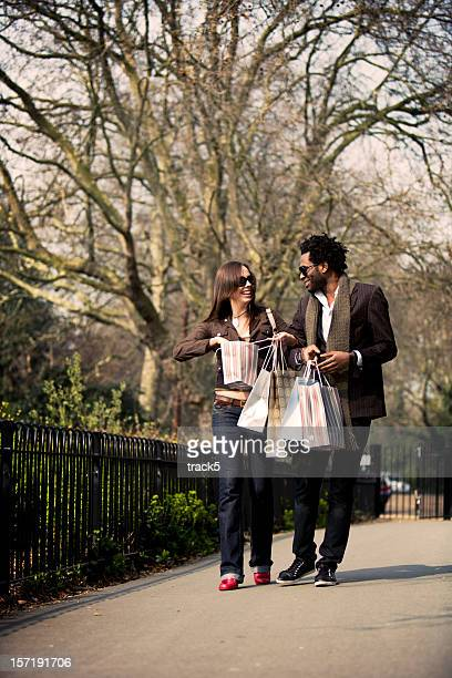 mixed-race couple sharing their delight of shopping