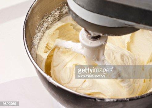 Mixer beating yellow cake icing