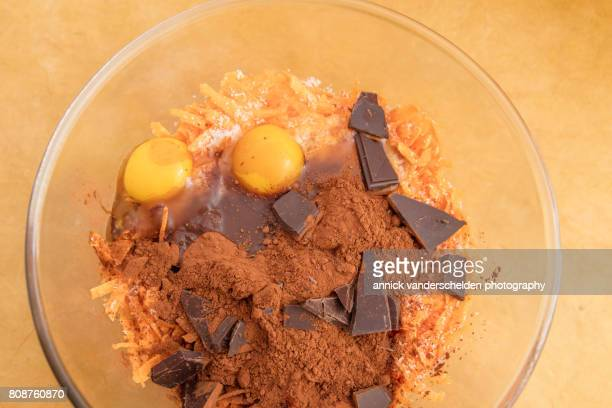 Mixing bowl with ingredients to make a brownie of sweet potato.