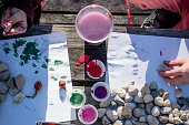 Kids are painting rocks during craft time in the gardens