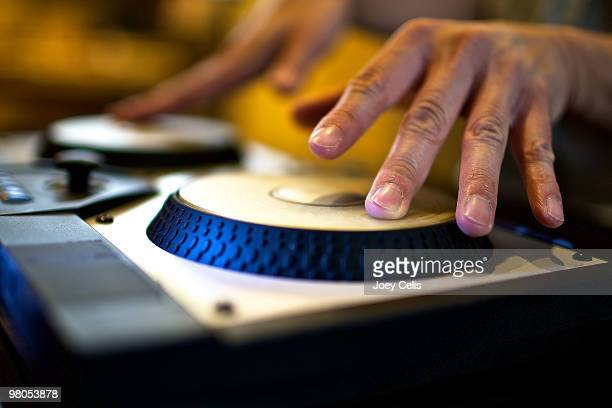 DJ mixing up music using digital turntables