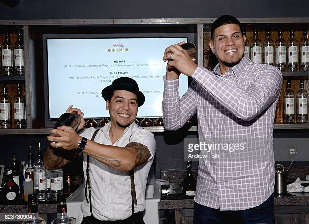 Mixologist Moses Laboy and professional baseball pitcher Dellin Betances create the perfect cocktail during the 2016 Eater Awards with Ketel One...