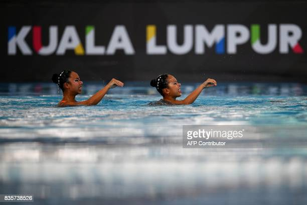 Miya Yong Hsing and Debbie Soh Li of Singapore compete in the women's synchronised swimming duet free routine final of the 29th Southeast Asian Games...