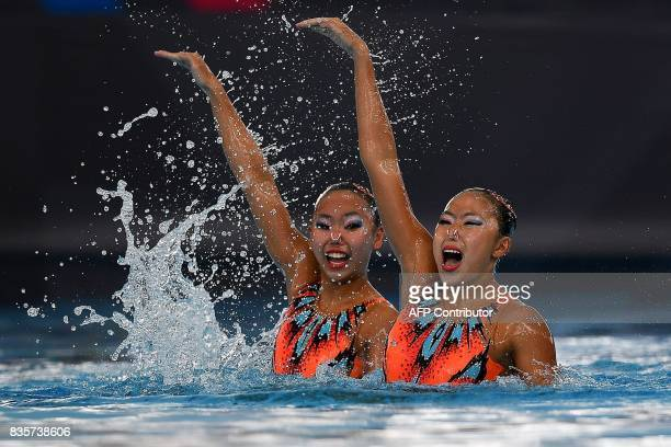 TOPSHOT Miya Yong Hsing and Debbie Soh Li of Singapore compete in the women's synchronised swimming duet free routine final of the 29th Southeast...