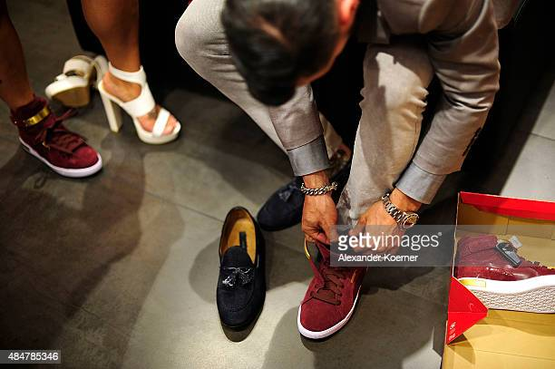 Miyabi Kawai and Manuel Cortez attend the Late Night Shopping at Designer Outlet Soltau on August 21 2015 in Soltau Germany