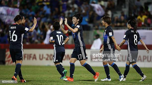 Miyabi Moriya of Japan congratulates Shiho Matsubara of Japan on her second goal during the FIFA U20 Women's World Cup Papua New Guinea 2016 Quarter...