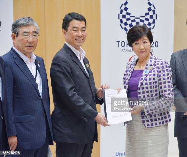 Miyagi Gov Yoshihiro Murai meets with Tokyo Gov Yuriko Koike on Aug 22 at the metropolitan government offices to request that the flame torch relay...