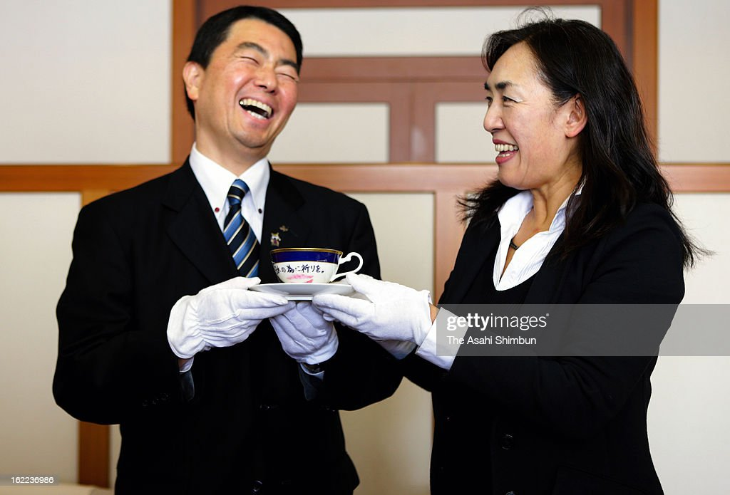 Miyagi Prefecture Governor Yoshihiro Murai (L) received the tea cup an saucer that Lady Gaga auctioned for the Great East Japan Earthquake and following tsunami charity, at Miyagi Prefecture headquarters on February 20, 2013 in Sendai, Miyagi, Japan. The successful bidder and dentist Akihisa Yumi, who had contributed to identify the victims of the quake and tsunami by checking the teeth marks, now in the hospital with Idiopathic Pulmonary Fibrosis, donated the cup that he spent approximately 6 million Japanese Yen, to Miyagi Prefecture in hope of the disaster not to be forgotten.