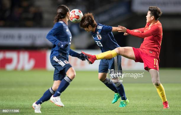 Miyake Shiori of Japan and Li ying of China in action during the EAFF E1 Women's Football Championship between Japan and China at Fukuda Denshi Arena...