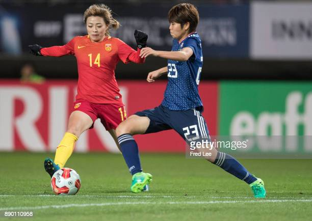 Miyake Shiori of Japan and Xu yanlu of china in action during the EAFF E1 Women's Football Championship between Japan and China at Fukuda Denshi...