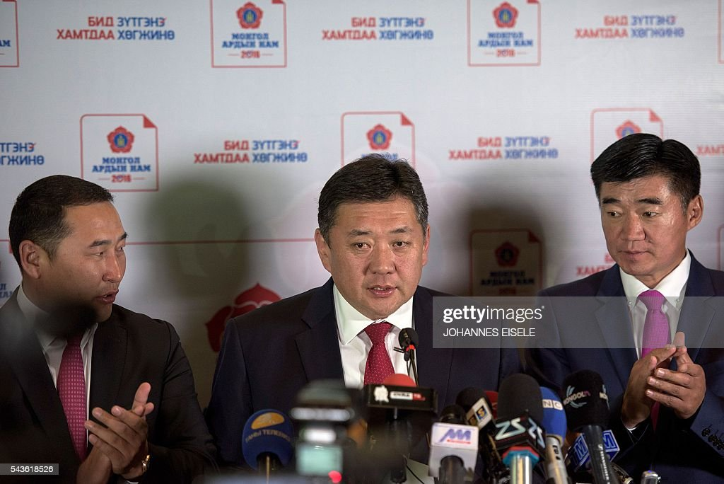 Miyegombiin Enkhbold (C), chairman of Mongolian People's Party (MPP) speaks to the press in Ulan Bator in the night of June 30, 2016. Mongolians went to the polls across their sprawling, sparsely-populated country on June 29 as it struggles to benefit from its vast natural resources amid disputes over foreign investment and slumping demand from neighbouring China. It took Mongolian nomad Pagvajaviin Shatarbaatar seven days to get to his polling station to vote in in the general election -- accompanied by more than 2,000 sheep, goats and horses. EISELE