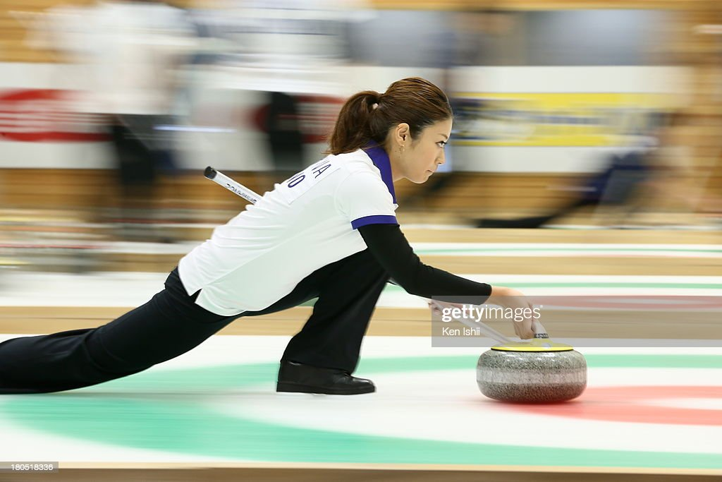 Miyo Ichikawa of Chubu Electric Power Co. throws a stone on during the last day of qualifier for the Curling Japan Qualifying Tournament at Dohgin Curling Stadium on September 14, 2013 in Sapporo, Japan.