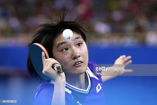 Miyu Kato of Japan competes Liu Gaoyang of China in table tennis Mixed International Team Gold Medal match during day seven of the Nanjing 2014...