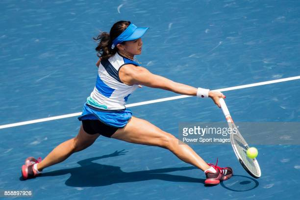 Miyu Kato of Japan hits a return during her women's singles qualifying match of the Prudential Hong Kong Tennis Open 2017 between Miyu Kato of Japan...