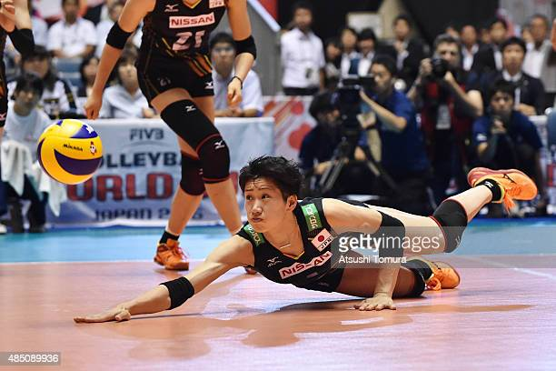 Miyu Nagaoka of Japan dives to receive the ball in the match between Cuba and Japan during the FIVB Women's Volleyball World Cup Japan 2015 at Yoyogi...