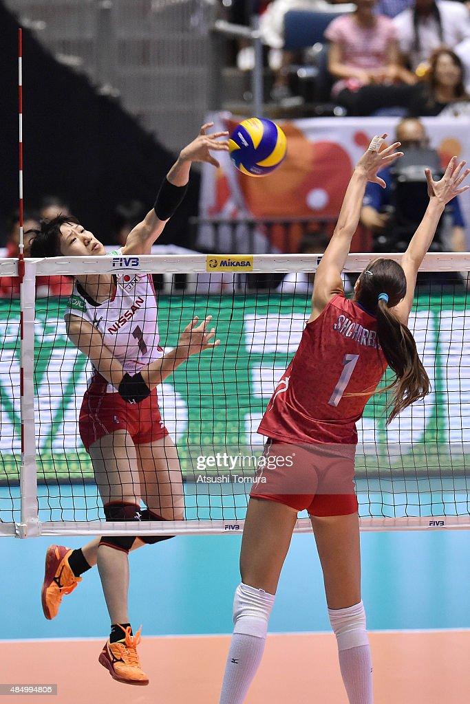 <a gi-track='captionPersonalityLinkClicked' href=/galleries/search?phrase=Miyu+Nagaoka&family=editorial&specificpeople=11310850 ng-click='$event.stopPropagation()'>Miyu Nagaoka</a> of Japan spikes in the match between Japan and Russia during the FIVB Women's Volleyball World Cup Japan 2015 at Yoyogi National Stadium on August 23, 2015 in Tokyo, Japan.