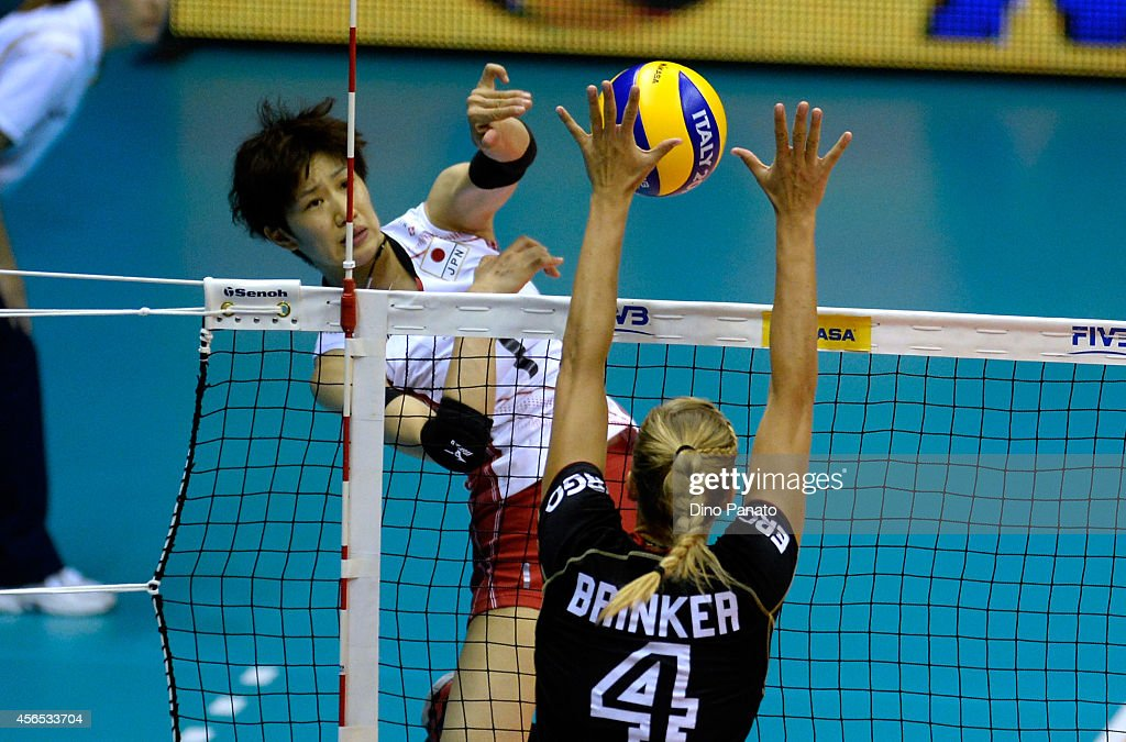 <a gi-track='captionPersonalityLinkClicked' href=/galleries/search?phrase=Miyu+Nagaoka&family=editorial&specificpeople=11310850 ng-click='$event.stopPropagation()'>Miyu Nagaoka</a> of Japan spikes the ball against to <a gi-track='captionPersonalityLinkClicked' href=/galleries/search?phrase=Arisa+Takada&family=editorial&specificpeople=13600892 ng-click='$event.stopPropagation()'>Arisa Takada</a> during the FIVB Women's World Championship pool E match between Germany and Japan on October 2, 2014 in Trieste, Italy .