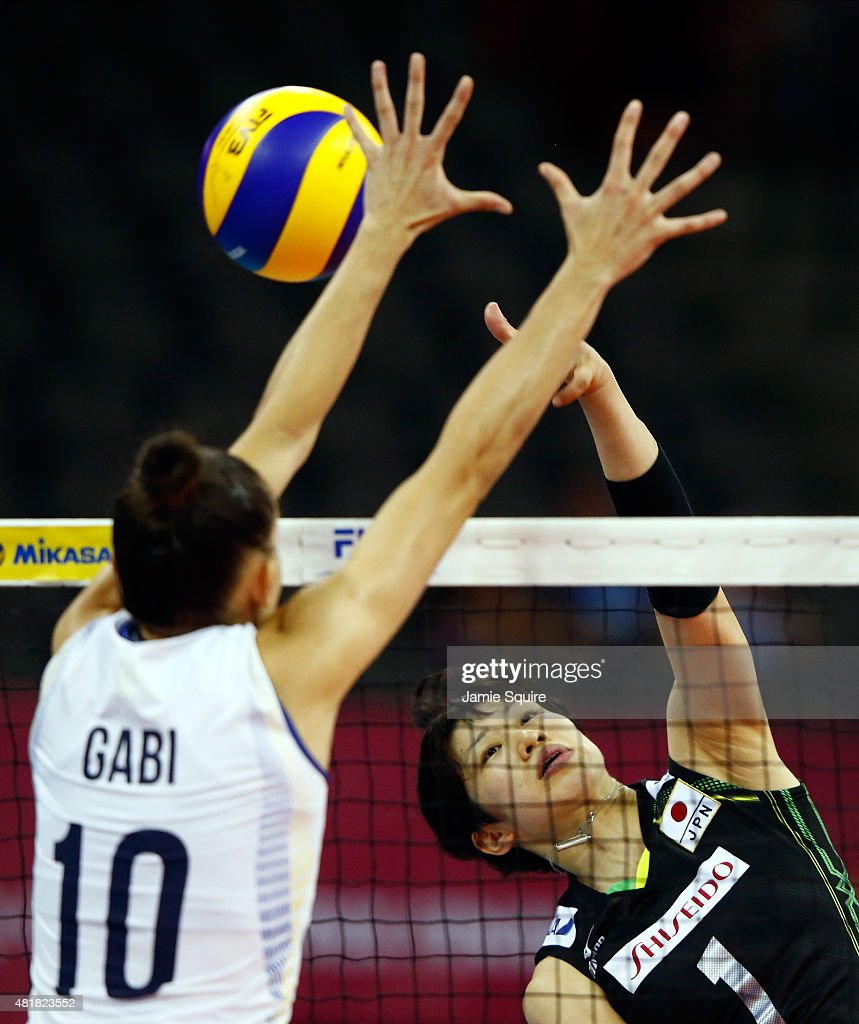 <a gi-track='captionPersonalityLinkClicked' href=/galleries/search?phrase=Miyu+Nagaoka&family=editorial&specificpeople=11310850 ng-click='$event.stopPropagation()'>Miyu Nagaoka</a> #1 of Japan spikes the ball as Gabiriela Braga Guimaraes #10 of Brazil defends during day 3 of the FIVB Volleyball World Grand Prix on July 24, 2015 in Omaha, Nebraska.