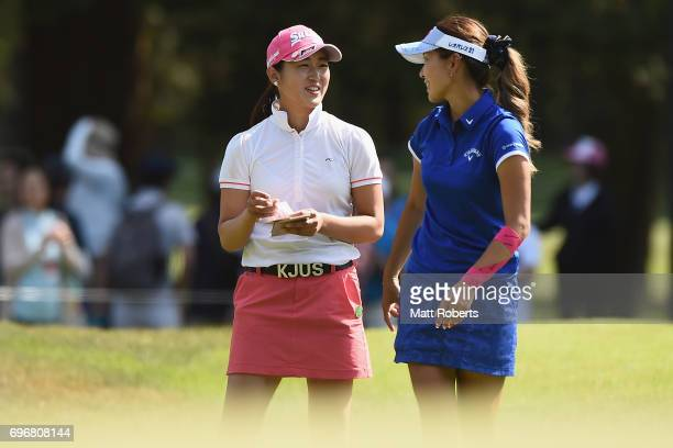 Miyu Shinkai and Hikari Fujita of Japan share a laugh on the 18th green during the second round of the Nichirei Ladies at the on June 17 2017 in...