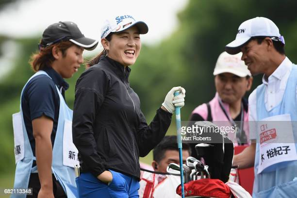 Miyu Shinkai of Japan shares a laugh before her tee shot on the 10th hole during the first round of the HokennoMadoguchi Ladies at the Fukuoka...