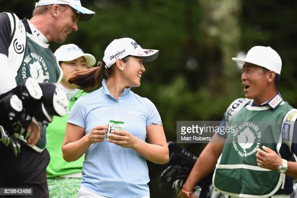 Miyu Shinkai of Japan shares a laugh during the first round of the NEC Karuizawa 72 Golf Tournament 2017 at the Karuizawa 72 Golf North Course on...