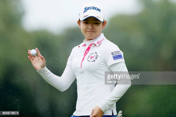 Miyu Yamato of Japan acknowledges after her putt on the 18th green during the final round of the Yupiteru The Shizuoka Shimbun SBS Ladies at the...