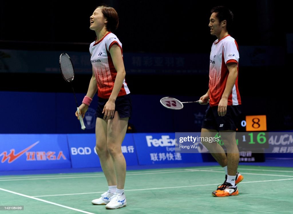 <a gi-track='captionPersonalityLinkClicked' href=/galleries/search?phrase=Miyuki+Maeda&family=editorial&specificpeople=2538262 ng-click='$event.stopPropagation()'>Miyuki Maeda</a> and Noriyasu Hirata (R) of Japan react during their match against Kang Ji Wook and Eom Hye Won of Korea during day Three of the 2012 Badminton Asia Championship at Qingdao Guoxin Gymnasium on April 19, 2012 in Qingdao, China.