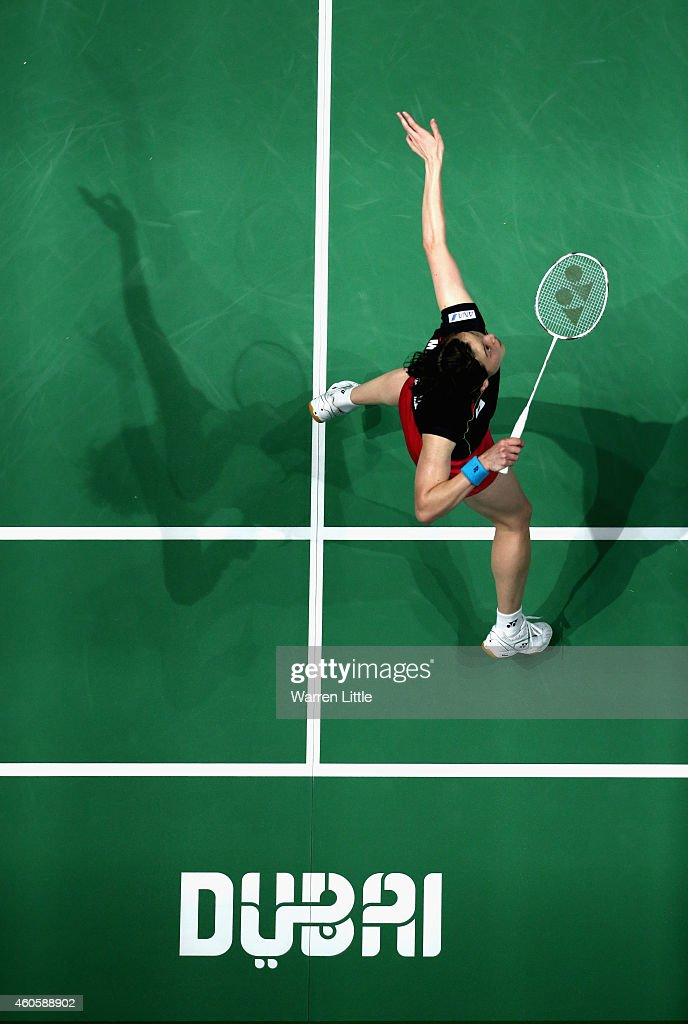 <a gi-track='captionPersonalityLinkClicked' href=/galleries/search?phrase=Miyuki+Maeda&family=editorial&specificpeople=2538262 ng-click='$event.stopPropagation()'>Miyuki Maeda</a> of Japan plays a shot in her double match against Indonesia during day one of the BWF Destination Dubai World Superseries Finals at the Hamdan Sports Complex on December 17, 2014 in Dubai, United Arab Emirates.
