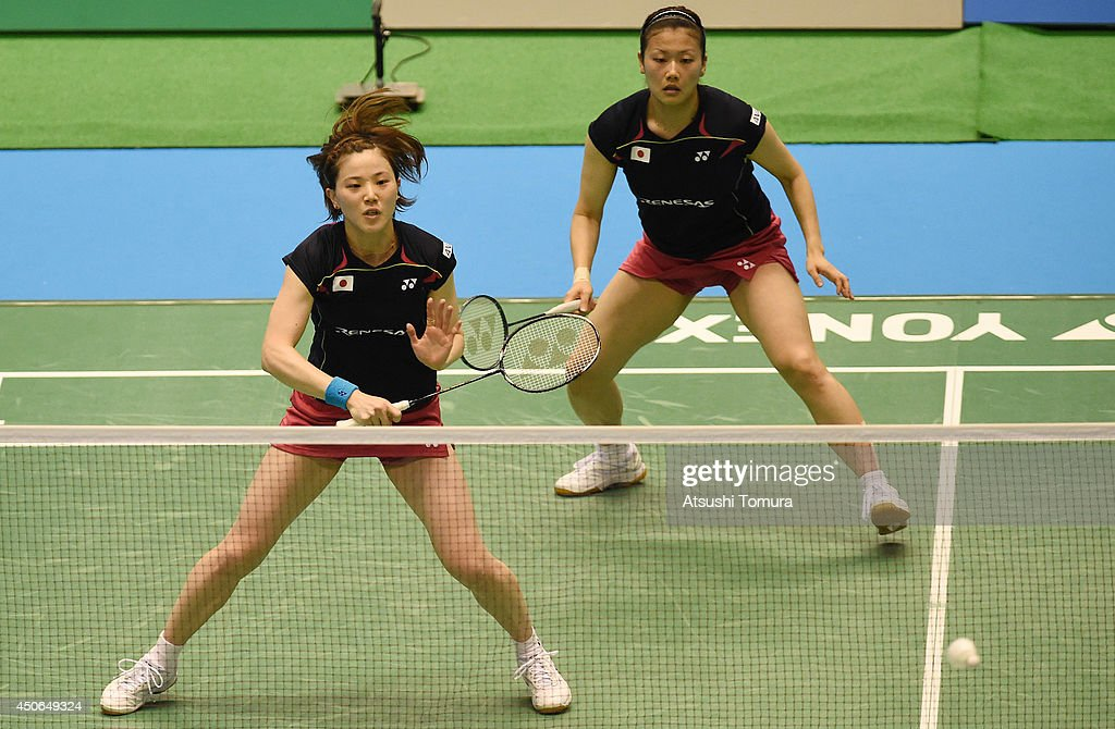 <a gi-track='captionPersonalityLinkClicked' href=/galleries/search?phrase=Miyuki+Maeda&family=editorial&specificpeople=2538262 ng-click='$event.stopPropagation()'>Miyuki Maeda</a> of Japan returns a shot as team mate <a gi-track='captionPersonalityLinkClicked' href=/galleries/search?phrase=Reika+Kakiiwa&family=editorial&specificpeople=6694817 ng-click='$event.stopPropagation()'>Reika Kakiiwa</a> watches on against Ayaka Takahashi and Misaki Matsutomo of Japan during day six of Badminton YONEX Open on June 15, 2014 in Tokyo, Japan.