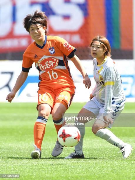 Miyuki Takahashi of Albirex Nigata and Miki Ito of INAC Kobe Leonessa compete for the ball during the Nadeshiko League match between Albirex Niigata...