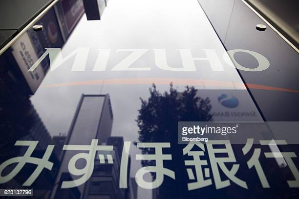 A Mizuho Bank Ltd branch stands in Tokyo Japan on Monday Nov 14 2016 Mizuho Financial Group Incs secondquarter profit beat analysts estimates barely...