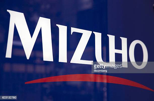 A Mizuho Bank Ltd logo is displayed at one of the company's branches in Tokyo Japan on Monday Nov 14 2016 Mizuho Financial Group Incs secondquarter...
