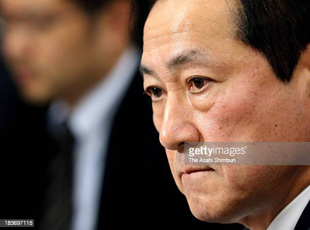 Mizuho Bank President Yasuhiro Sato speaks on his bank's latest scandal involving loans to members of crime syndicates at a news conference at Bank...