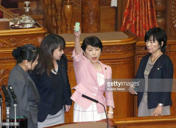 Mizuho Fukushima a Social Democratic Party lawmaker holds her ballot before voting against a bill to criminalize the planning of serious crimes...